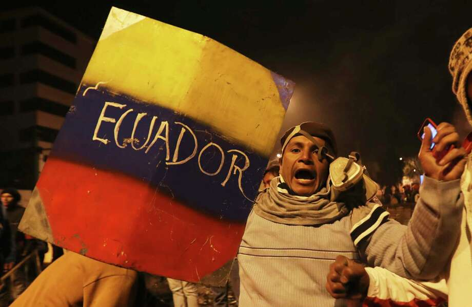 Mass protests in Ecuador, Oct. 13, 2019Indigenous and protesters celebrate the announcement that the government cancelled an austerity package that triggered violent protests, in Quito, Ecuador, Sunday, Oct. 13, 2019. Ecuadorian President Lenin Moreno and leaders of the country's indigenous peoples have struck a deal to cancel the disputed austerity package and end nearly two weeks of protests that have paralyzed the economy and left several people dead. Photo: Dolores Ochoa, AP / Copyright 2019 The Associated Press. All rights reserved