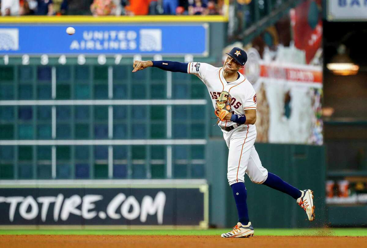 Astros shortstop Carlos Correa throws out the Yankees' DJ LeMahieu at home for the final out of the sixth inning on a play that loomed large in the Astros' victory.