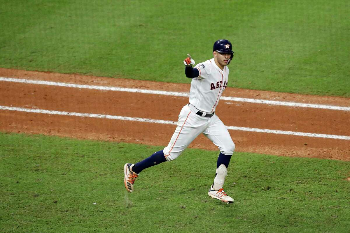 Astros shortstop Carlos Correa celebrates hitting a walk-off home run in the eleventh inning Sunday for a 3-2 win over the Yankees in Houston. Correa was pointing for Laredo's Jalen Garcia who he told Friday in a visit to the MD Anderson Cancer Center that the next home run he hit would be for him.