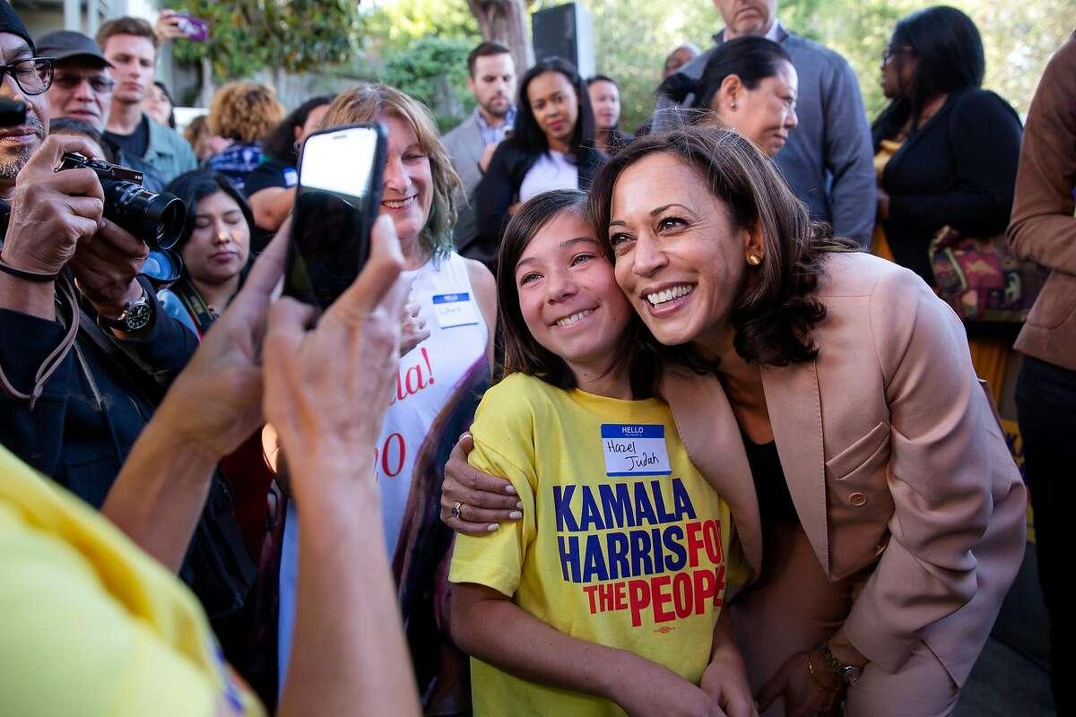 Senator Kamala Harris takes a photo with Hazel Judah, 13, from Petaluma during the official opening of Sen. Harris' Hometown Headquarters California campaign office in Oakland, Calif. on Sunday, September 29, 2019.