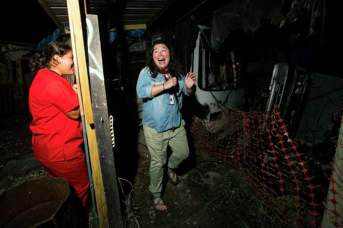 Scenes from the Phobia Haunted House as workers try to scare reporter Julie Garcia on Oct. 4, 2019, in Houston.