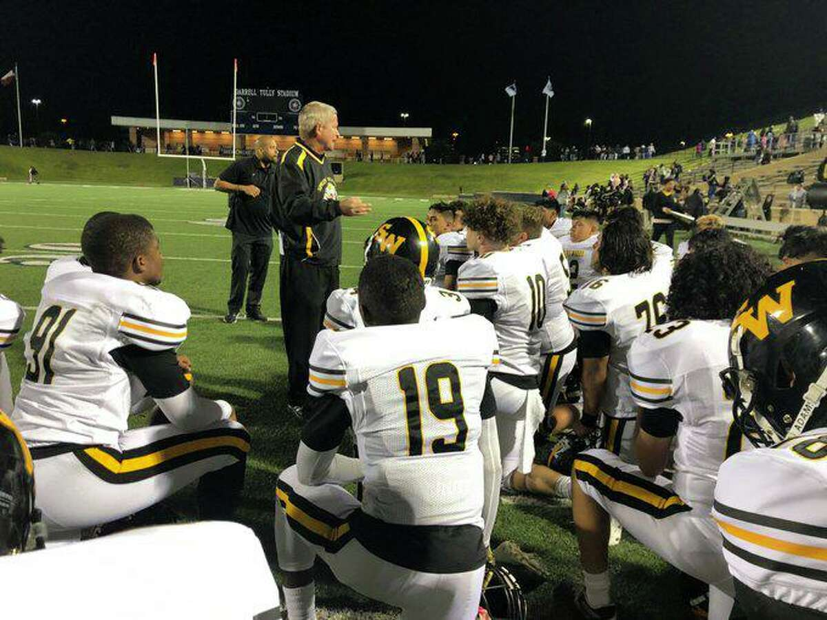 Spring Woods coach Keith Cripps addresses his team following a 16-5 victory against Northbrook Oct. 11 at Tully Stadium.
