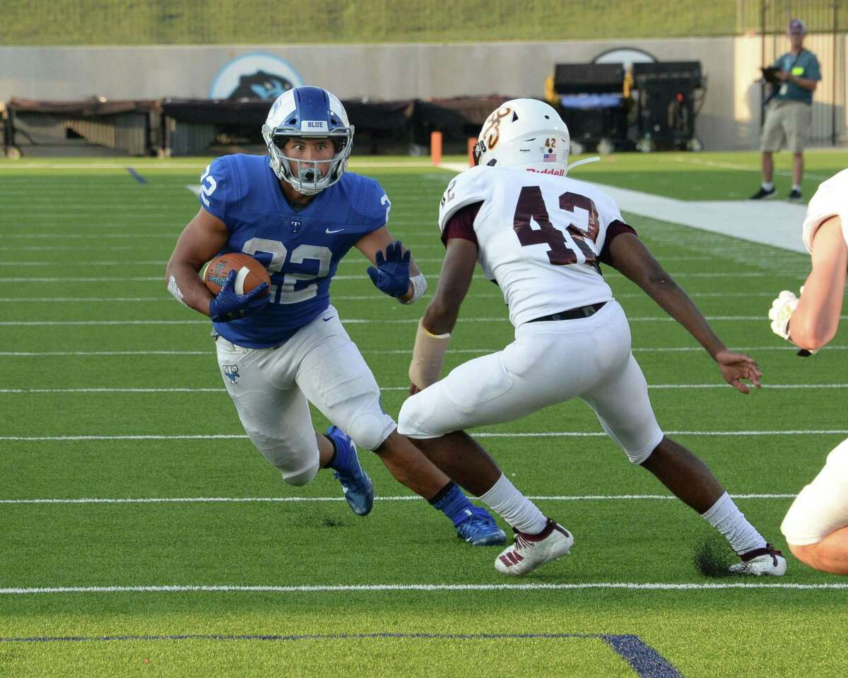 Casey Shorter (22) of Taylor carries the ball following a reception during the first quarter of a non-district football game between the Katy Taylor Mustangs and the Deer Park Deer on Saturday, September 14, 2019 at Legacy Stadium, Katy, TX.