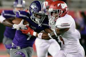 Ridge Point wide receiver Keenon Pitts, left, fends off the tackle of North Shore defensive back Jordan Polart during the second half of a high school football game, Thursday, Sept. 5, 2019, at TDECU Stadium at the University of Houston.