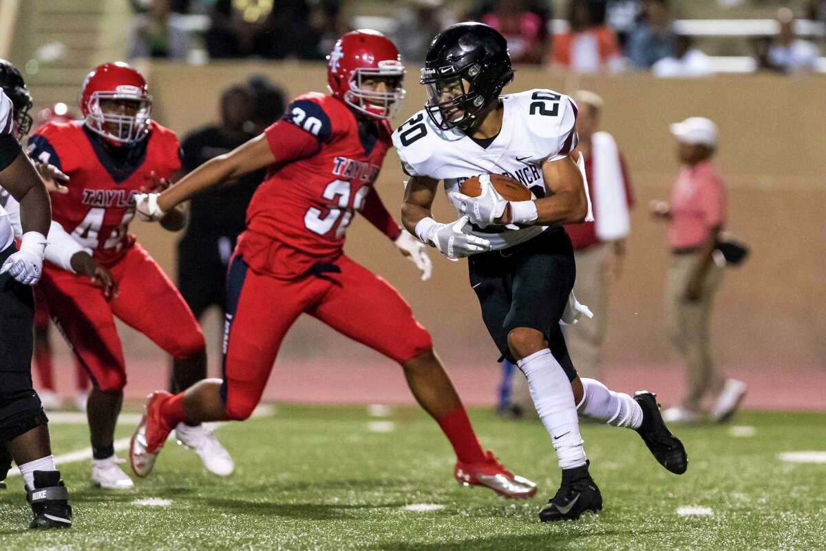 George Ranch running back Hymond Drinkard (20) carries the ball for a first down in the second half of a high school football game Thursday, Oct 10, 2019, in Houston.