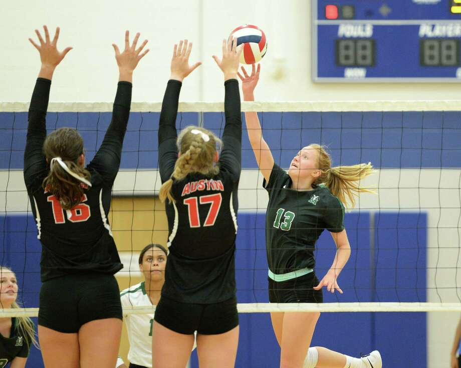 Katherine Griese (13) of Mayde Creek attempts a shot past Rachel Pringle (16) and Sydney Piemons (17) of Austin during the second set of a volleyball match between the Mayde Creek Rams and the Ft Bend Austin Bulldogs on Thursday, August 8, 2019 at Taylor HS, Katy, TX. Photo: Craig Moseley, Staff / Staff Photographer / ©2018 Houston Chronicle