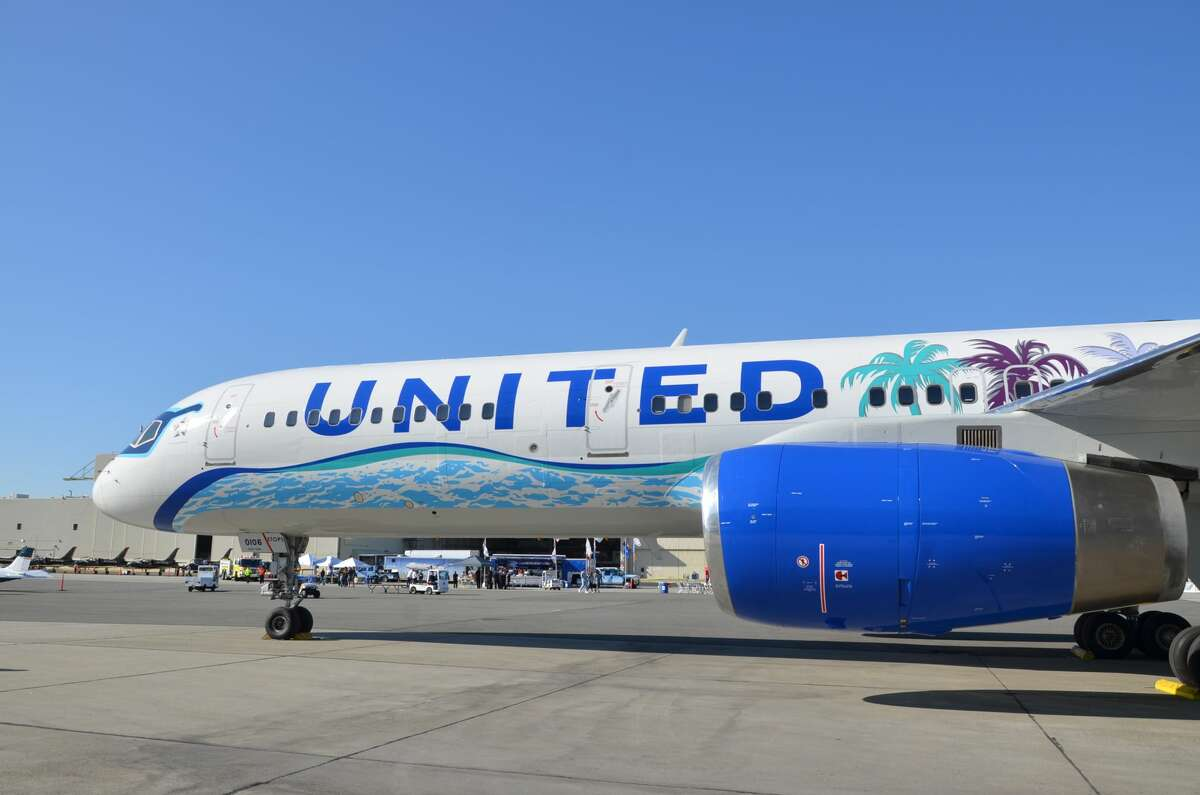 United is slashing schedules, offering employees unpaid leaves, and imposing a hiring freeze, which will reverberate throughout the Bay Area. Pictured: United's California-themed paint job that splashed on the side of a United Airlines Boeing 757-200 in happier times last year.