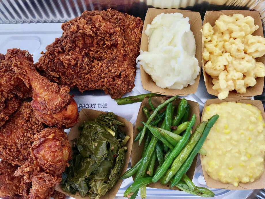 Fried chicken with classic sides from Ronnie Killen's pop-up for Killen's, the restaurant he plans to open in the former Hickory Hollow space at 101 Heights. Photo: Greg Morago
