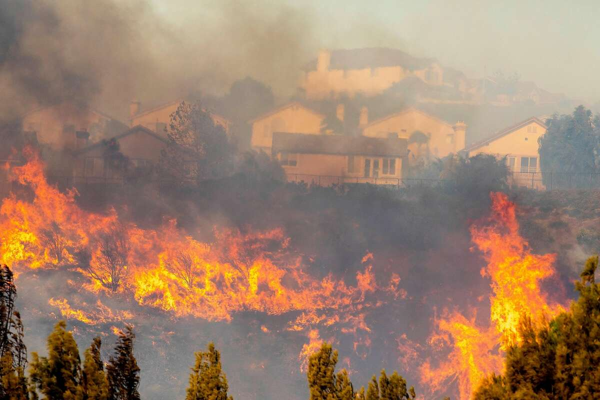 The Saddleridge fire burns in northwest Los Angeles on Friday, Oct. 11, 2019. A fire tore through Southern California overnight into Friday, forcing mandatory evacuations for more than 100,000 people and setting dozens of homes ablaze, just as power was being restored to hundreds of thousands of Northern Californians. (Kyle Grillot for The New York Times)