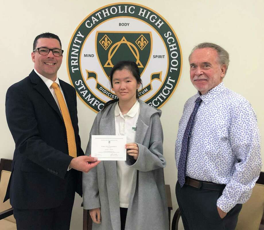 Trinity Catholic HIgh School student Lauren Young was named a commended student in the 2020 National Merit Scholarship Program. From left to right: Scott Smith, Trinity Principal, Lauren Young, Trinity Senior, John Carrigan, Trinity Guidance Director. Photo: Contributed / Contributed Photo / Westport News contributed