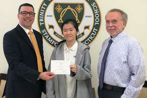 Trinity Catholic HIgh School student Lauren Young was named a commended student in the 2020 National Merit Scholarship Program. From left to right: Scott Smith, Trinity Principal, Lauren Young, Trinity Senior, John Carrigan, Trinity Guidance Director.