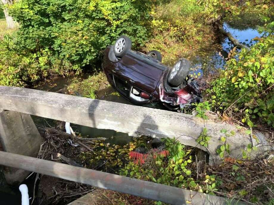 Car crashed and rolled over in the Transylvania Brook on Sunday afternoon. Photo: Southbury Fire Department / Facebook