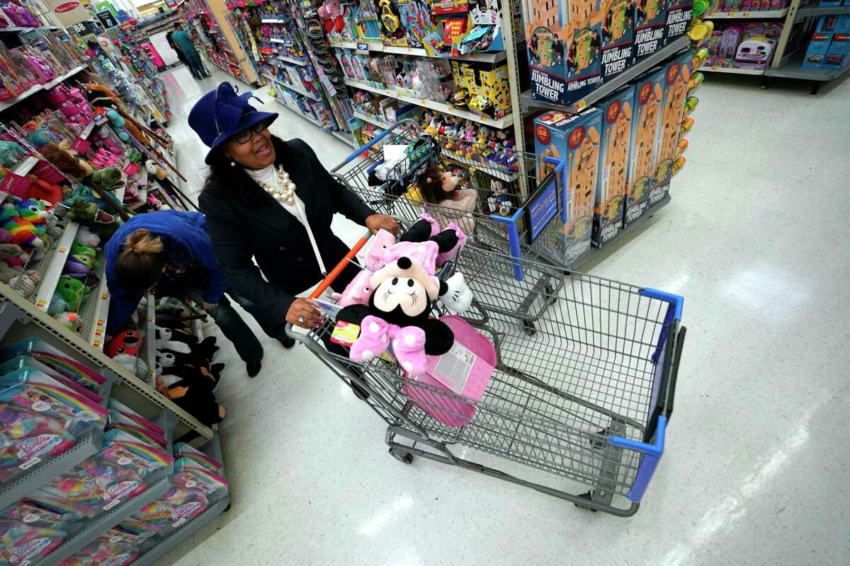 Shoppers make their way through the toy isles at a Walmart Supercenter in Houston.