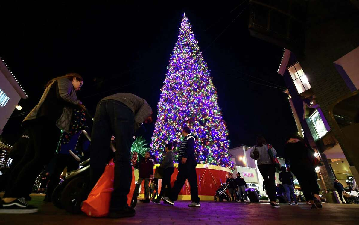 People shop for gifts a week before Christmas on Dec. 18, 2018 at an outlet mall in Commerce, California.