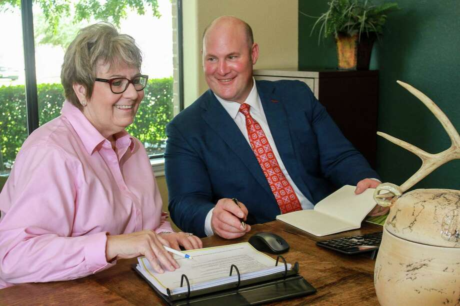 Branch Office Administrator, Paula Bush, and David Coney, Edward Jones Financial Advisor, prepare for a client appointment. Photo: Hearst Connecticut Media File Photo / © 2018 Gary Fountain