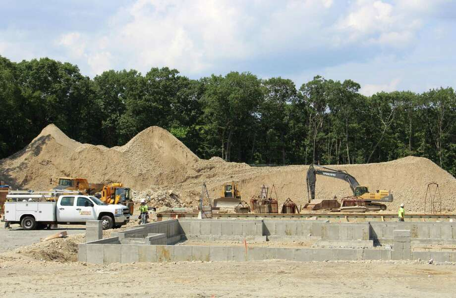 Construction of 202 units of apartment on the former Canon USA site at 100 Oakview Drive is ongoing in this August 2018 photo. Photo: Jordan Grice / Hearst Connecticut Media / Connecticut Post