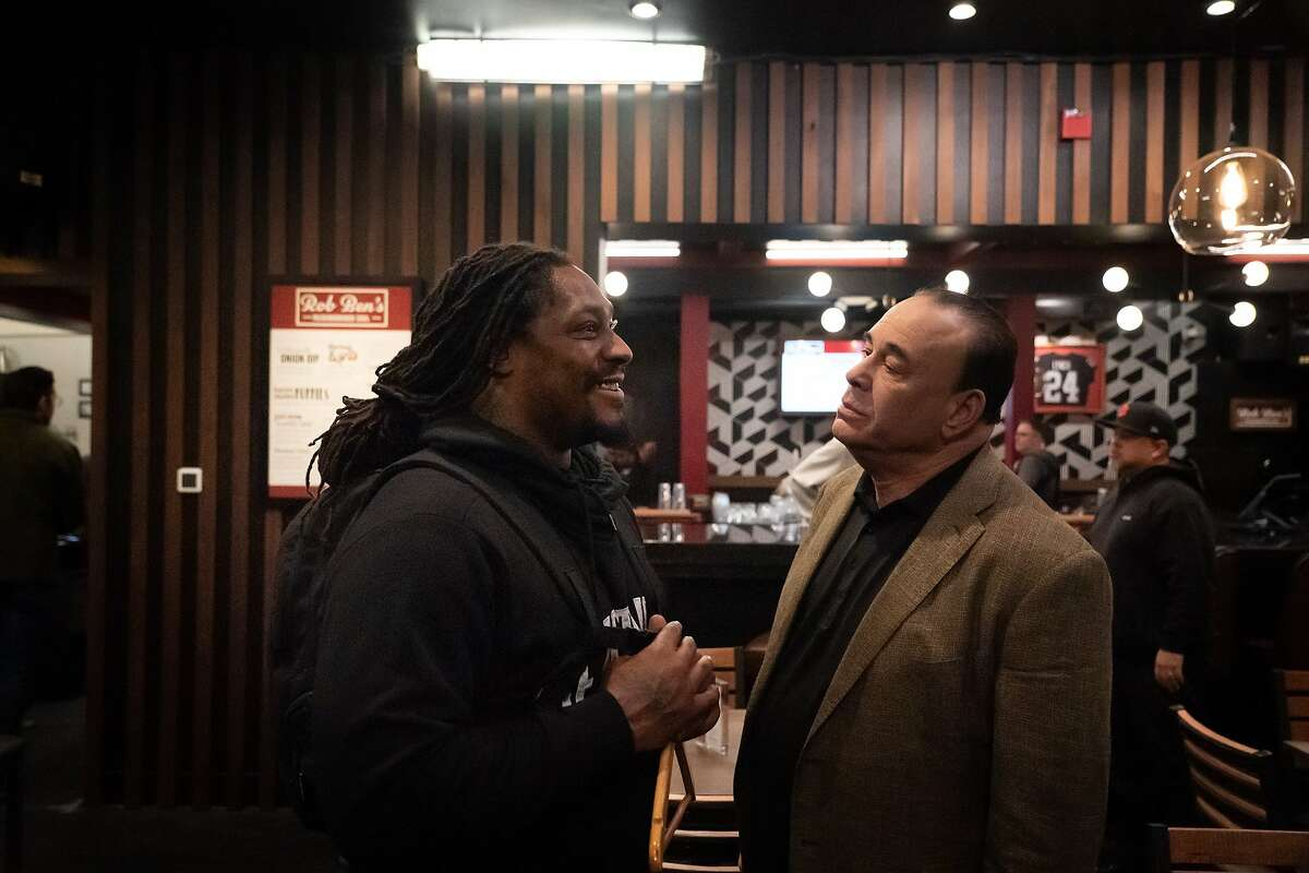 Marshawn Lynch, owner of Rob Ben's, and Bar Rescue host Jon Taffer, during the re-opening on Sunday, Oct. 13, 2019, in Oakland, Calif.