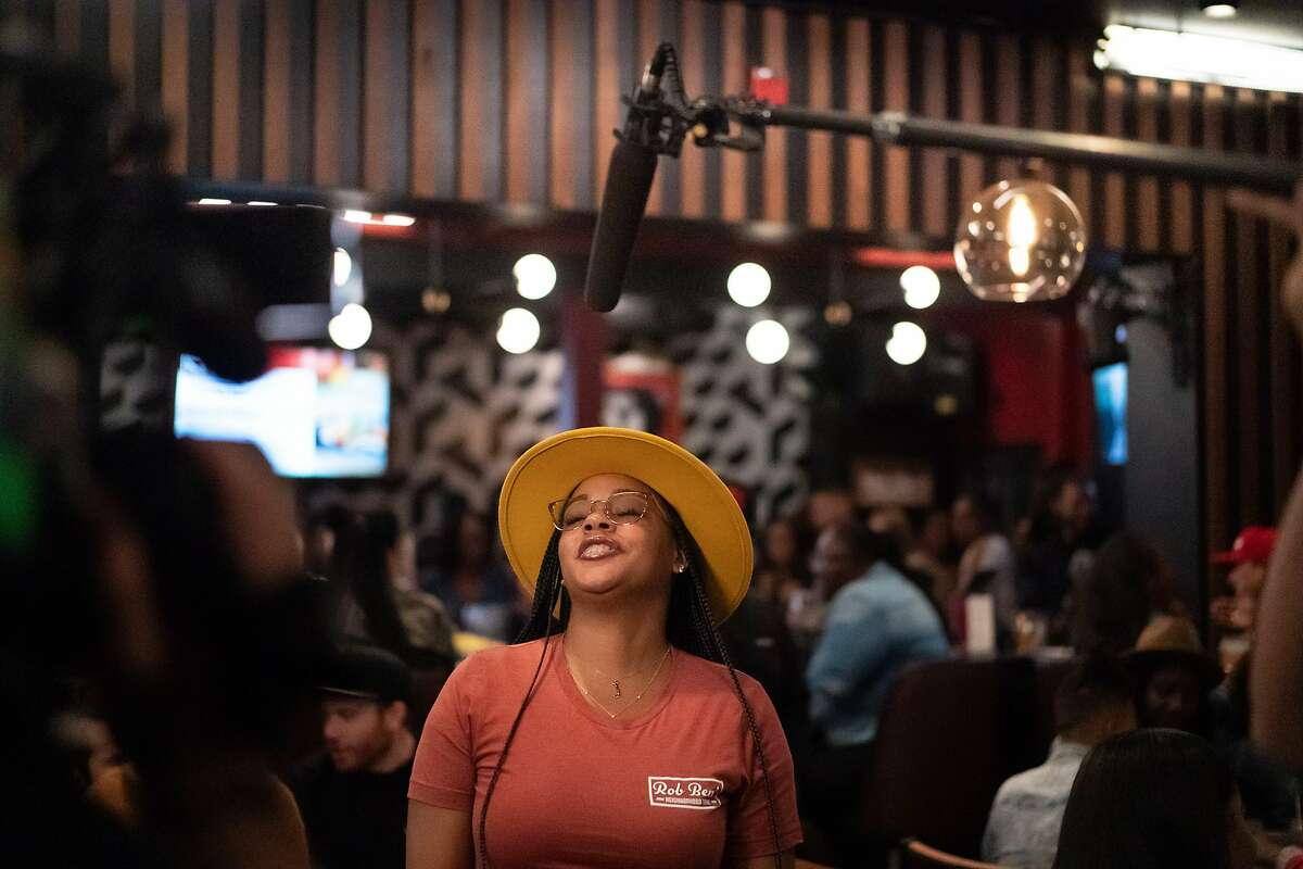 Waitress Desire Walker is interviewed at Marshawn Lynch's East Bay restaurant, Rob Ben's, during a filming of Bar Rescue on Sunday, Oct. 13, 2019, in Oakland, Calif.