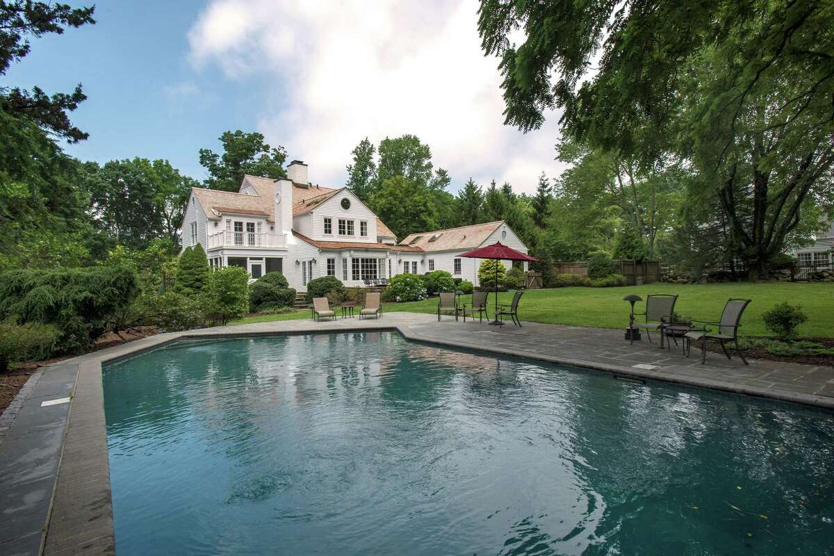 This property features agricultural and recreational amenities including an in-ground swimming pool and tennis court.