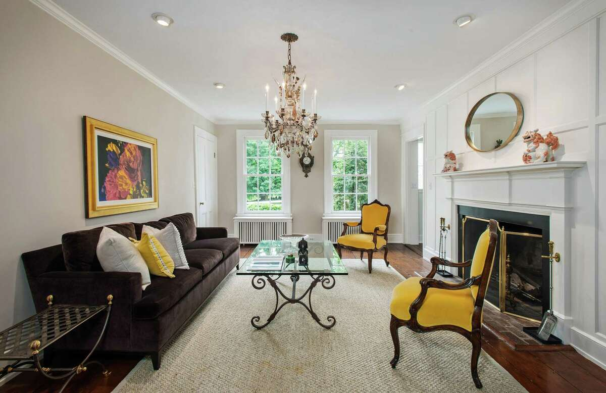 The formal living room features one of the home's three fireplaces.