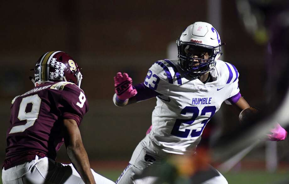 Humble senior wide receiver Dontee' McCray (23) works for extra yards after a catch against Summer Creek senior defensive back Taylor Leonard (9) during the 4th quarter of their District 22-6A matchup at Turner Stadium on Oct. 11, 2019 Photo: Jerry Baker, Houston Chronicle / Contributor / Houston Chronicle