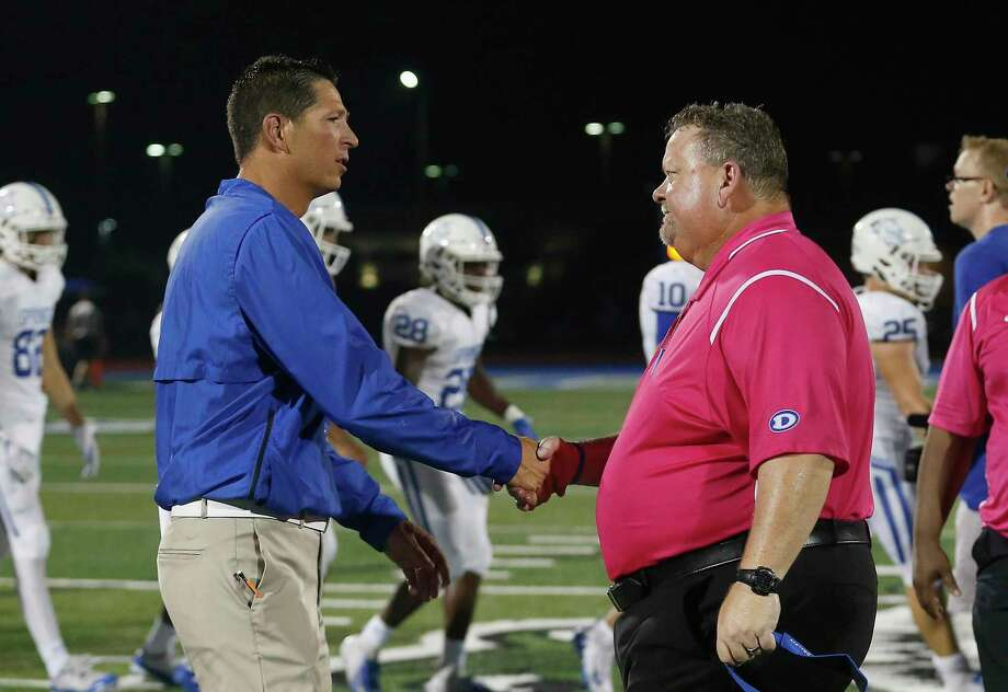 Head football coaches Craig Dailey of Clear Springs (left) and John Snelson of Dickinson will match wits Friday when the Chargers host the Gators in a key District 24-6A battle at Challenger Columbia Stadium. Photo: Tim Warner, Houston Chronicle / Contributor / ©Houston Chronicle