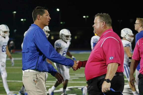 Head football coaches Craig Dailey of Clear Springs (left) and John Snelson of Dickinson will match wits Friday when the Chargers host the Gators in a key District 24-6A battle at Challenger Columbia Stadium.