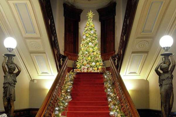 """Norwalk's Lockwood-Mathews Mansion Museum is celebrating the holiday season with """"Toys, Trains, and Magnificent Trees: Illuminating Christmas at the Mansion."""" Staircase decor is designed by Danna DiElsi, of The Silk Touch; the 12-foot-tall tree is designed by Vandamm Interiors."""