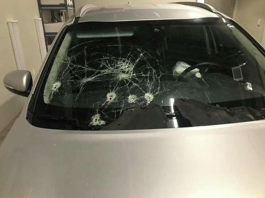 Wood River Police have released a photo of a stolen car involved in an armed robbery of a Verizon store in Wood River on Sunday. Police said the vehicle's bullet holes occured before Sunday's theft; three men are awaiting formal charges in connection to the incident.