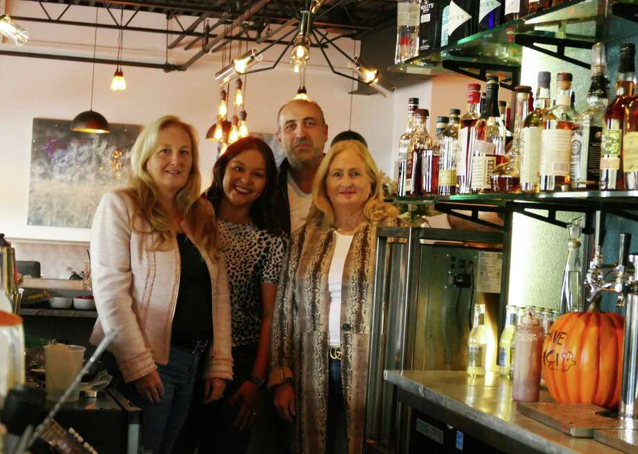 From left to right: Stephanie Heering, Tashi Fleming, Massimo Carro, and Siobhan Santini behind the bar at Posa on Danbury Road. Carro, the restaurant's owner, has welcomed Heering and Santini to guest bartend for Angel of Ridgefield on Oct. 24. Photo: /