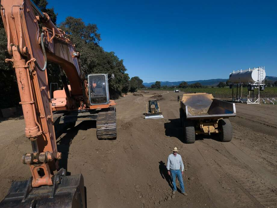 Farmer Tom Gamble, below, has given 10 acres of land along the sides of the Napa River (tree lined at left) so it can flow naturally on Saturday, Oct. 5, 2019, in Napa, Calif. Photo: Paul Kuroda / Special To The Chronicle
