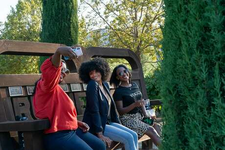 Jhermanie Woods takes a selfie with Justina White and V-Neesa Gabriel in the garden at The Prisoner on Saturday, Sept. 28, 2019, in Saint Helena, Calif. Photo: Paul Kuroda / Special To The Chronicle