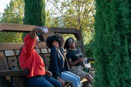 Jhermanie Woods takes a selfie with Justina White and V-Neesa Gabriel in the garden at The Prisoner on Saturday, Sept. 28, 2019, in Saint Helena, Calif.