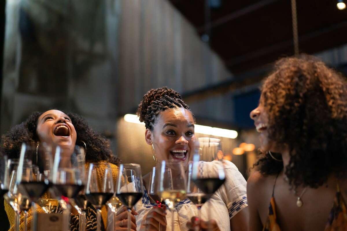 Monique Pascual, Jwahir Leaks, and Amber Fretwell taste wine at The Prisoner on Saturday, Sept. 28, 2019, in Saint Helena, Calif.