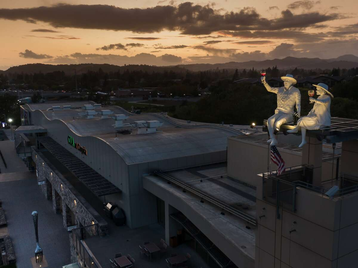 A sculpture of Robert and Margrit Mondavi, who inspired the creation of the Napa food, wine, and fine arts center in 2001, sits on the roof of the CIA on Sunday, Sept. 29, 2019, in Napa, Calif.
