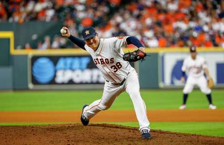 Houston Astros relief pitcher Joe Smith (38) pitches during the tenth inning of Game 2 of the American League Championship Series at Minute Maid Park on Sunday, Oct. 13, 2019, in Houston.