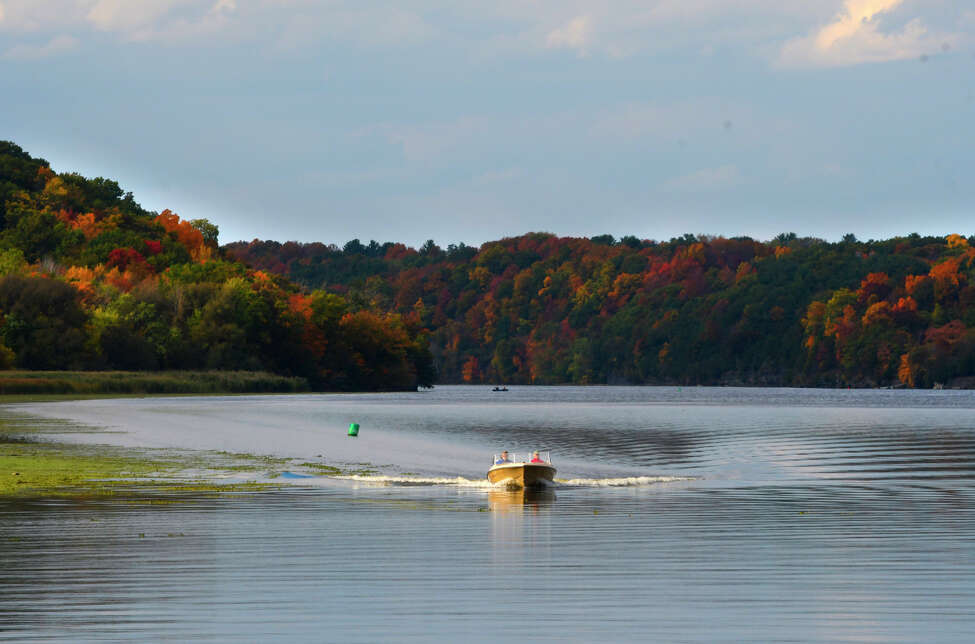 A boat is piloted south on the Mohawk River on Monday, Oct. 14, 2019, in Niskayuna, N.Y. (Paul Buckowski/Times Union)