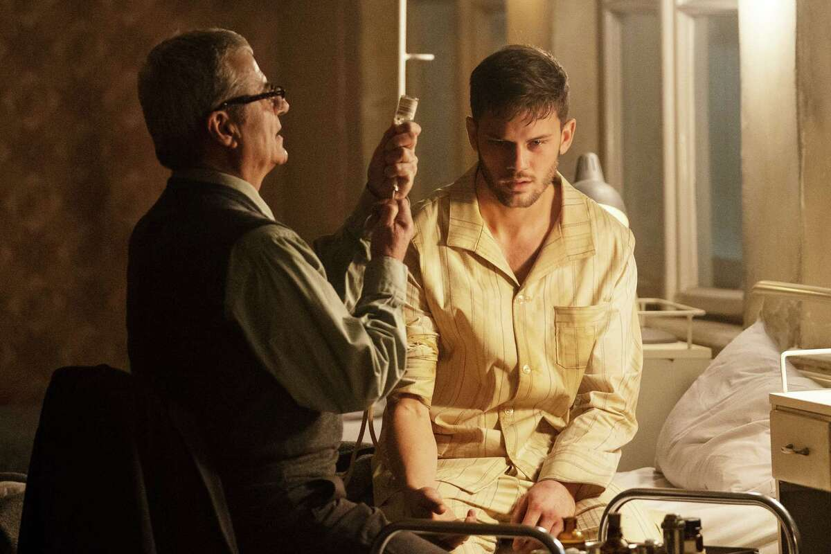 TREADSTONE -- Episode 101 -- Pictured: (l-r) Martin Umbash as Dr. Meisner, Jeremy Irvine as J. Randolph Bentley -- (Photo by: Jonathan Hession/USA Network)