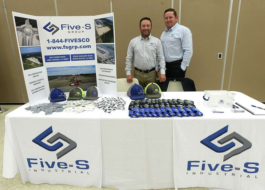 Brandon Soileau and Brnadon Ashley pose at their Five-S Group booth during the Golden Pass LNG forum held at the Bob Bowers Civic Center in Port Arthur Tuesday. Area vendors, contractors and other business were invited to learn more about the Golden Pass LNG export project.  Photo taken Tuesday, June 18, 2019  Kim Brent/The Enterprise Photo: Kim Brent / The Enterprise / BEN