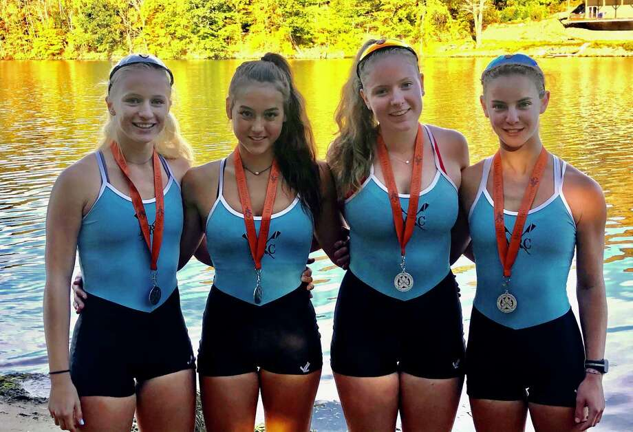 Maritime Rowing Club Women's Junior Quad members, from left, Merel Sutherland, Alexis Zitzmann, Ellie Davies and Josephine Williams, with their gold medals on the banks of the Housatonic River on Saturday, Oct. 12, 2019. Photo: Contributed / Hearst Connecticut Media / Hearst Connecticut Media