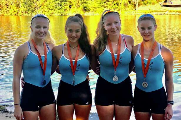 Maritime Rowing Club Women's Junior Quad members, from left, Merel Sutherland, Alexis Zitzmann, Ellie Davies and Josephine Williams, with their gold medals on the banks of the Housatonic River on Saturday, Oct. 12, 2019.