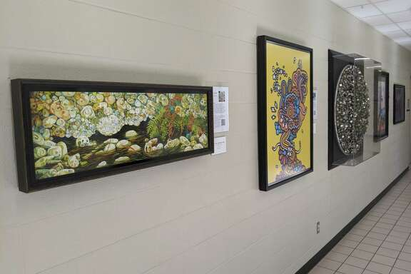 Pieces from The Woodlands High School Art Trust adorn the walls of the school on all three floors, so the students can engage with the art they picked on a daily basis.