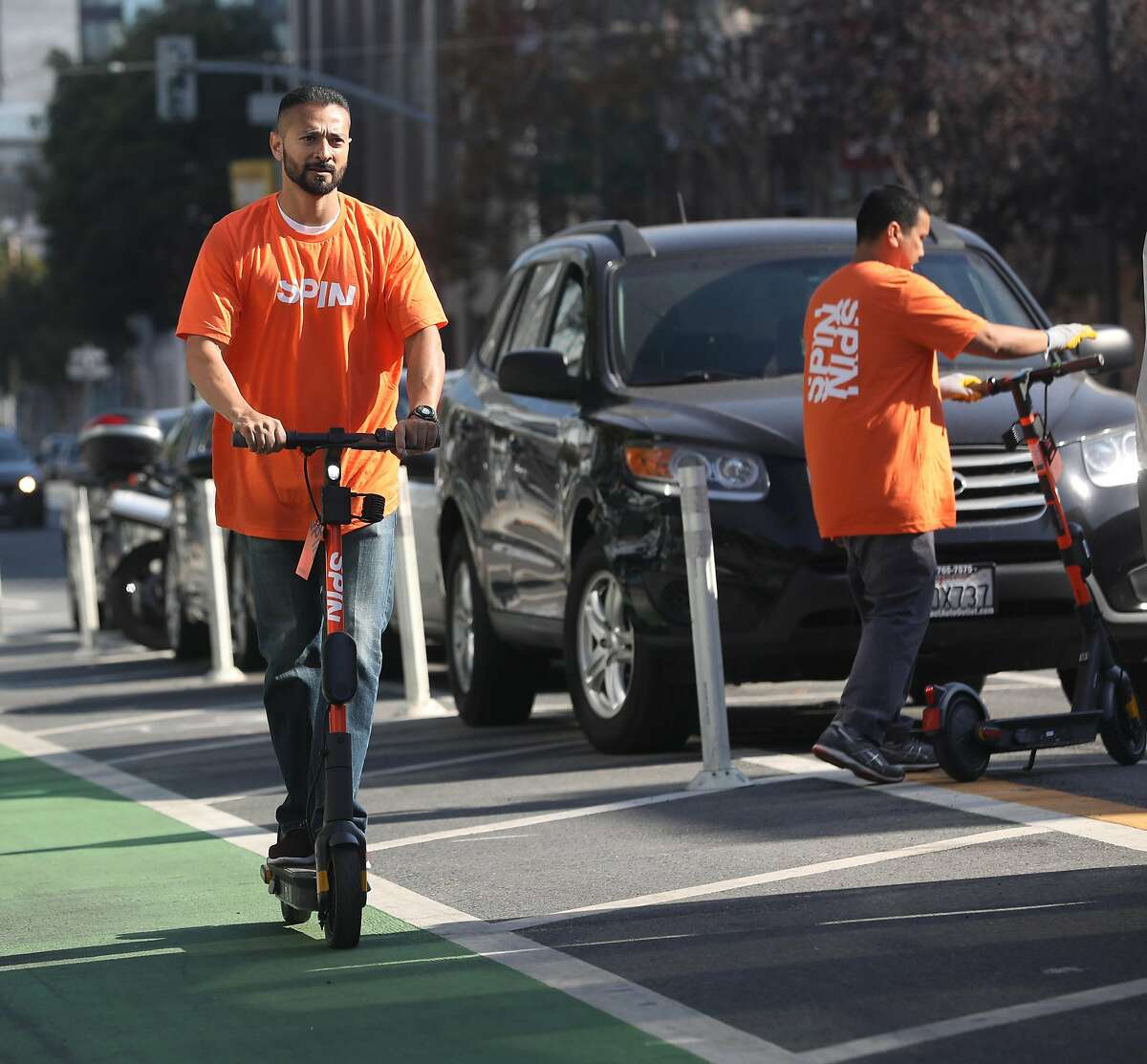 Spin staffer Jose Magano tries out a scooter as he prepares for the launch tomorrow on Monday, Oct. 14, 2019, in San Francisco, Calif.
