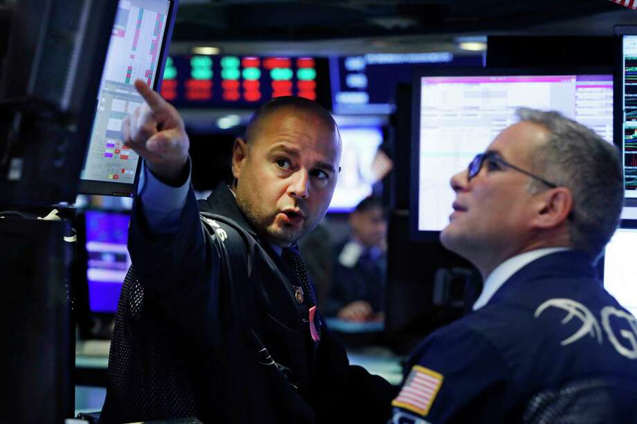 FILE - In this Oct. 7, 2019, file photo specialists Mario Picone, left, and Anthony Rinaldi work on the floor of the New York Stock Exchange. The U.S. stock market opens at 9:30 a.m. EDT on Monday, Oct. 14. (AP Photo/Richard Drew, File) Photo: Richard Drew / Copyright 2019 The Associated Press. All rights reserved