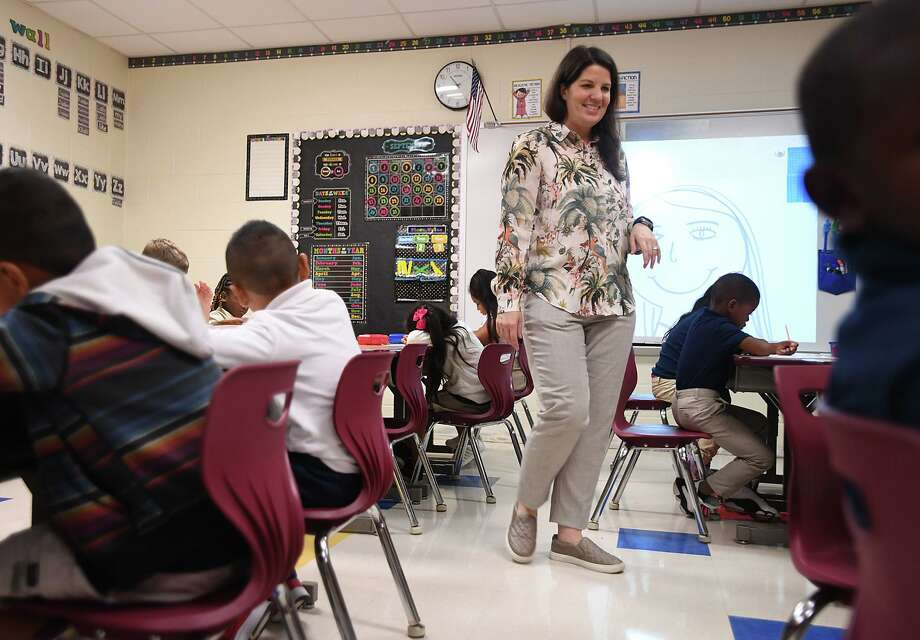 Fehl-Price Elementary students returned to class Monday morning for the first time since Tropical Depression Imelda flooded the campus in September. Jennifer Marlor works with her first grade class on a drawing exercise Monday.  Photo taken Monday, 10/14/19 Photo: Guiseppe Barranco/The Enterprise, Photo Editor / Guiseppe Barranco ©
