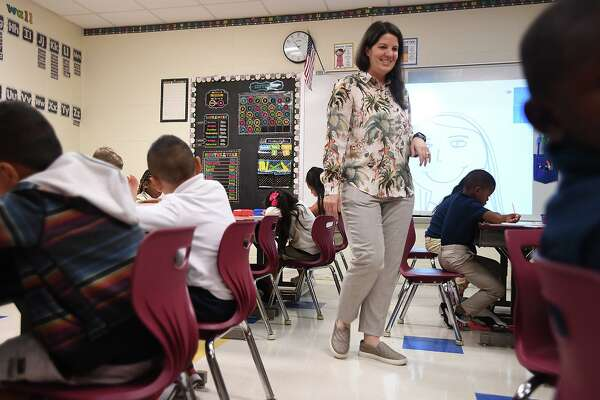 Fehl-Price Elementary students returned to class Monday morning for the first time since Tropical Depression Imelda flooded the campus in September. Jennifer Marlor works with her first grade class on a drawing exercise Monday. Photo taken Monday, 10/14/19