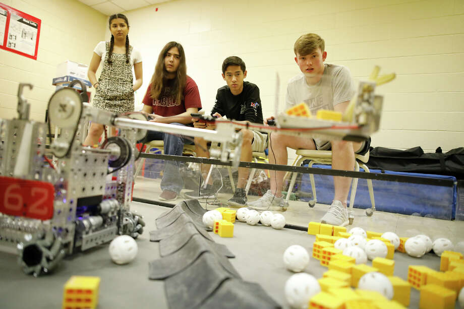 Members of Lee High School's Samurai Robotics team practice March 28 at the school. The team advanced to world competition last school year -- just one of many accomplishments by local students. Photo: MRT File Photo / © 2019 All Rights Reserved