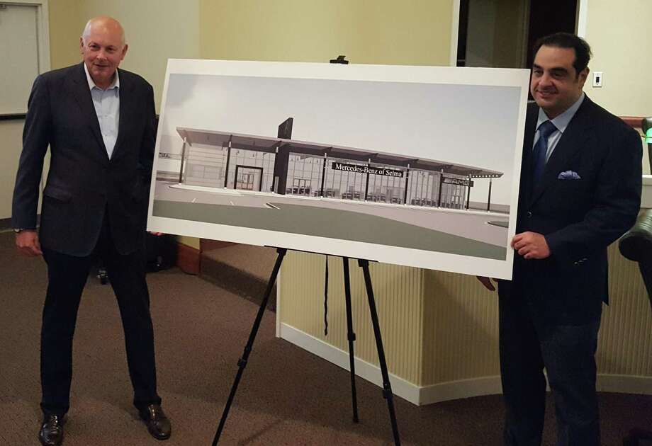 Mercedes-Benz dealer principal Bill Berardino, left, and Manuel Kadre, Mercedes-Benz owner, unveil an illustration of their plans for a dealership in Selma. Photo: Jeff B. Flinn /Staff