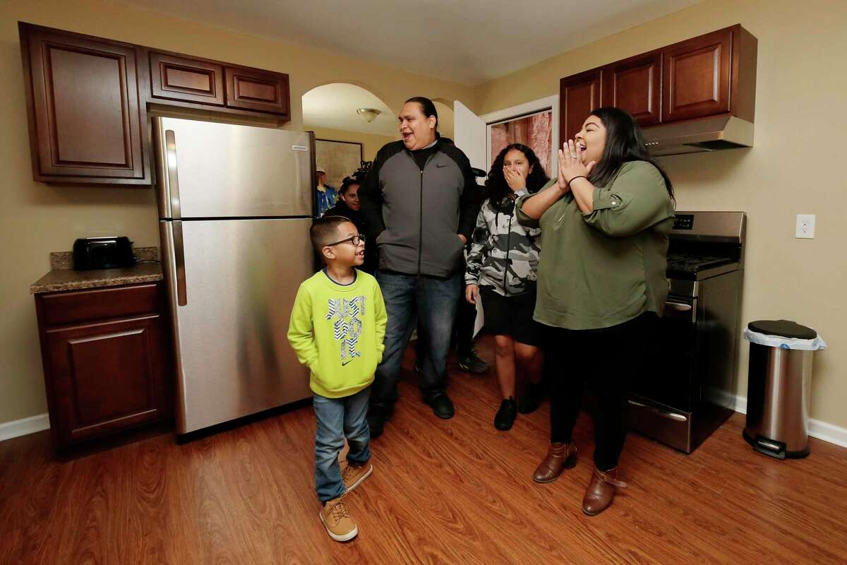 The Beltran-Martinez family sees their new kitchen for the first time.