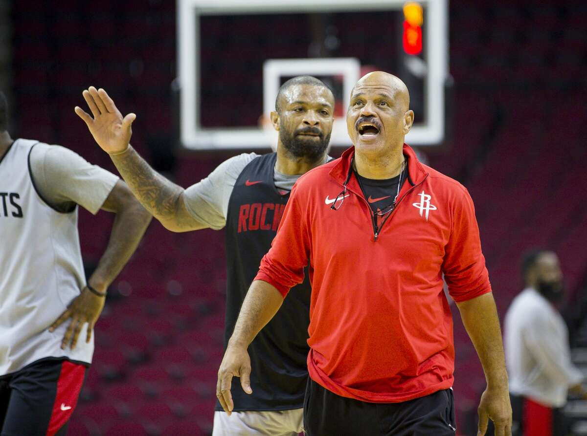 Houston Rockets forward PJ Tucker jokes with assistant coach John Lucas during a Houston Rockets practice open to fans at Toyota Center in Houston, Monday, Oct. 14, 2019.
